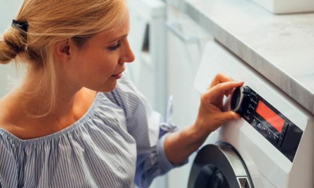Person switching on washing machine