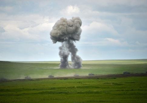 Russian Army Engineering tanks drive near the Baikal Lake on July 17 / AP