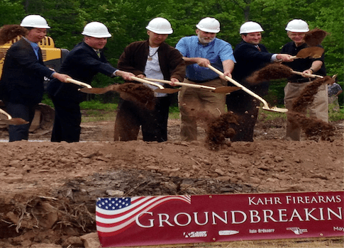 Kahr Firearms Group President Justin Moon (left) and Pennsylvania Lt. Gov. Jim Cawley (second from left), break ground on a new factory.