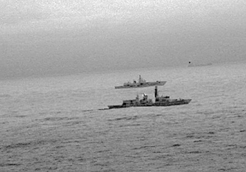 Images from an infrared camera on a helicopter show Royal Navy frigate HMS St Albans escorting Russian warship Admiral Gorshkov as it passes close to UK territorial waters