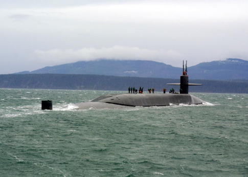 The guided missile submarine USS Ohio (SSGN 726) stops for a personnel boat transfer