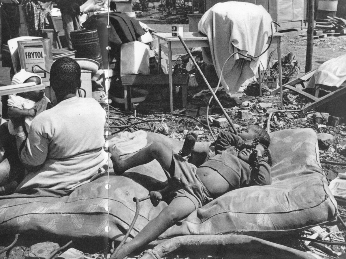 Victims of forced removals dumped outside with their belongs scattered all over and in shambles during the Apartheid era
