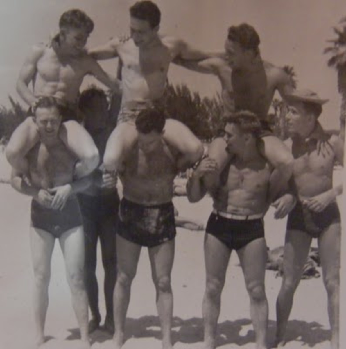 Back in those days, those surfer shorts did not exist; men could wear Speedos without having their sexuality thrown into question