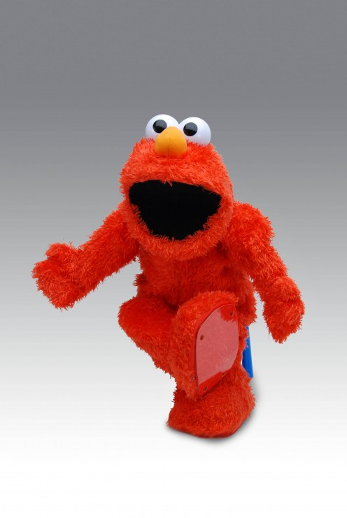 Elmo has always freaked me out, I think the colour combined with the size of his mouth and eyes and seriously people, the dude is naked.  Some clothes maybe and with pockets?