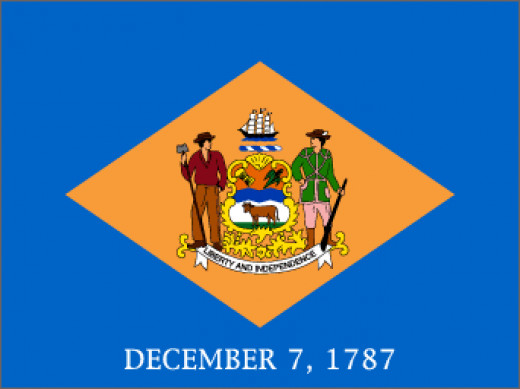 """. Below the  diamond are the words """"December 7, 1787,""""  indicating the day on which Delaware was the  first state to ratify the United States constitution"""