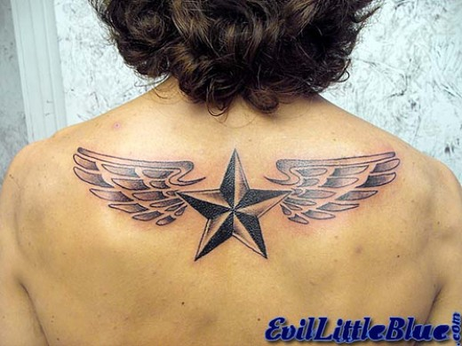This is a nice wing tattoo with a nautical star in the middle.