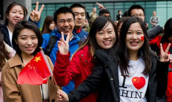 China to make permanent residency easier for foreigners - India.com