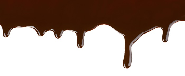 Melted Chocolate Dripping On White Background Wall Mural