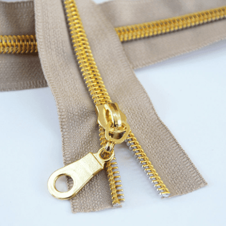 #5 beige zipper with gold coil