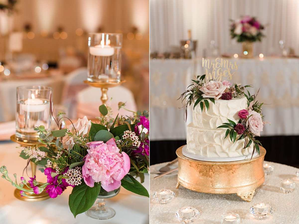 pink peonies and candles decorate reception tables at a ballroom wedding