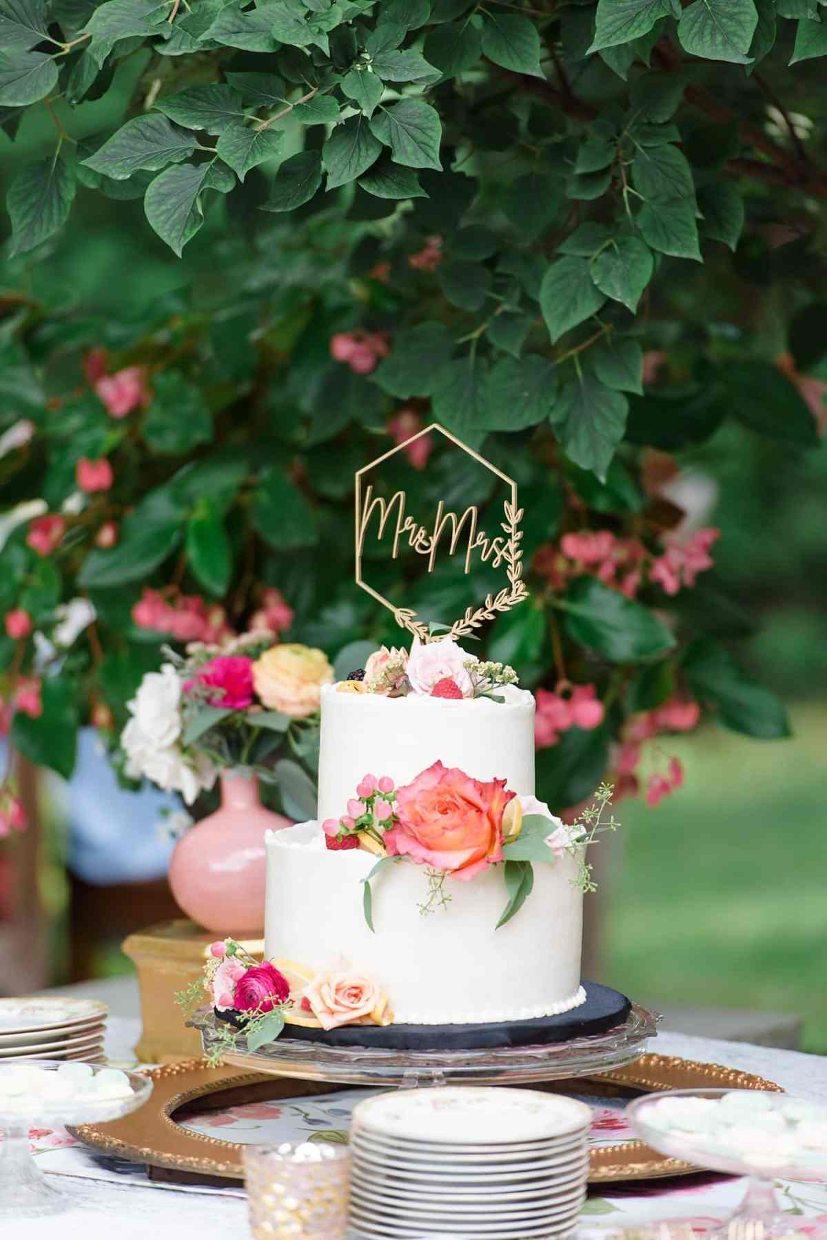 white wedding cake with coral flowers