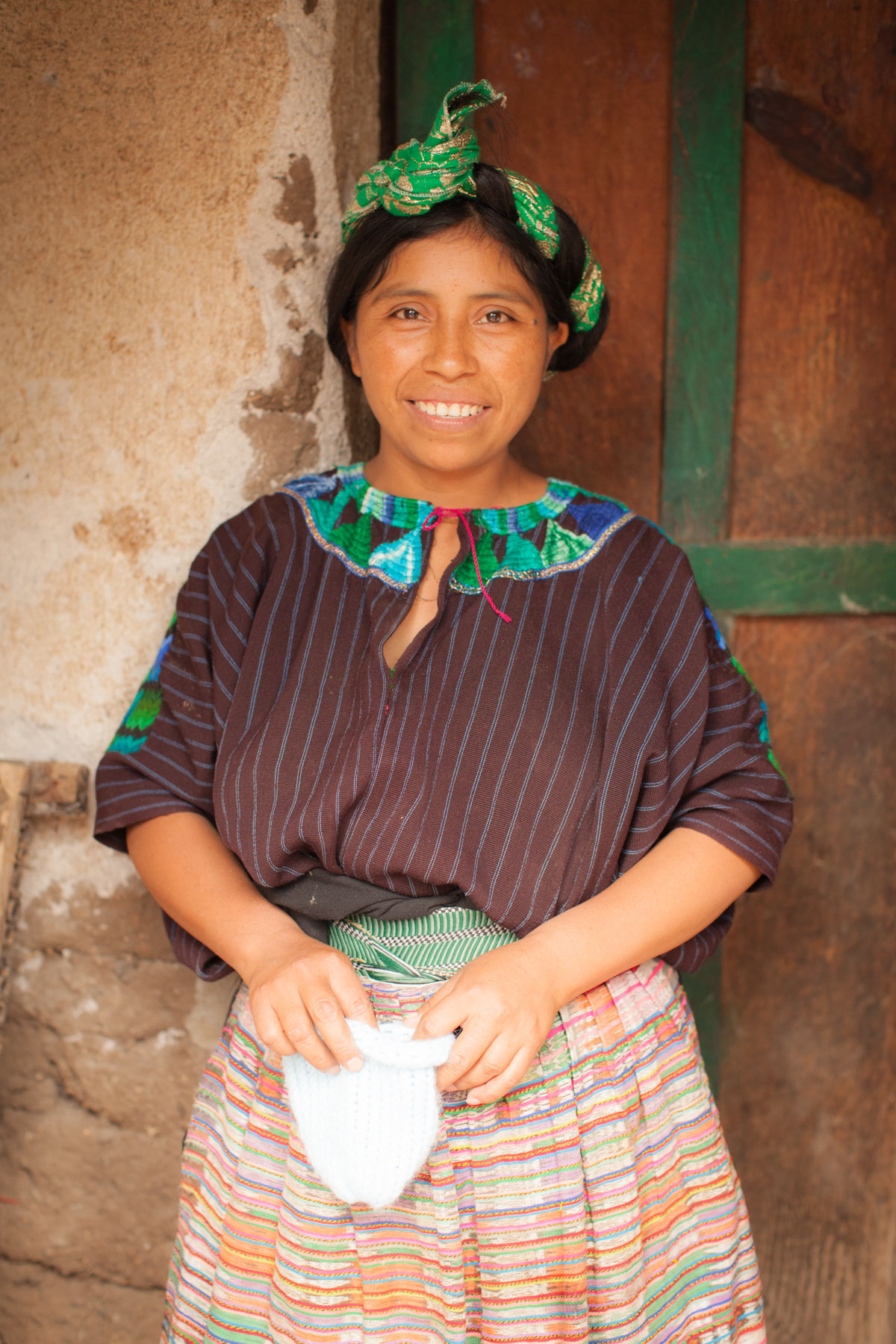 Mayan Guatemalan woman with handmade baby hat - Vezzani Photography