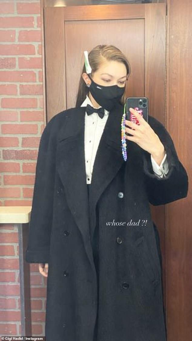 Trabajando duro: Gigi Hadid parecía estar en el set de una nueva sesión de fotos mientras modelaba una elegante pajarita negra y un abrigo a juego para sus casi 64 millones de seguidores el viernes.