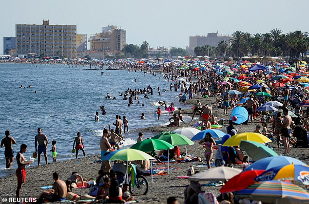 Families should expect a 'knock on the door' when they return from abroad, Priti Patel warned last night. Pictured: A beach inMalaga this month