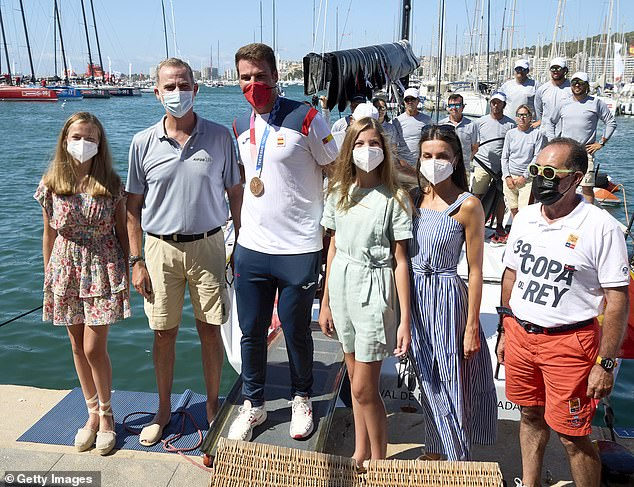 Queen Letizia and King Felipe VI of Spain met with Mallorcan sailor Joan Cardona in Palma yesterday to congratulate him on his Olympic bronze medal (pictured, along with daughtersPrincess Leonor (left) and Princess Sofia (right)