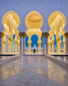 Lady walking to the Grand Mosque, Abu Dhabi