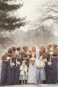 Philadelphia winter weddings are so beautiful. There is something so special about the gorgeous architecture of Philadelphia under a blanket of white snow. At this Philly winter wedding, the bride got ready with her bridesmaids at her parents' house in the suburbs before heading to the church for her wedding ceremony. When it's raining or snowing outside, I always ask my clients if they're comfortable going outdoors for portraits. I don't ever want brides or grooms to go out in inclement weather if they're not okay with it! This bride was totally willing to endure the snow for a few beautiful portraits, so we stepped into the street with her bridesmaids for a few quick images. I am so grateful and thankful to her and those ladies for braving that snow! What started out as a few simple flurries rapidly turned into a snowstorm, but they were willing to go out anyhow. If it's snowing on your wedding day, and you want to go outside, let's do it! If you're not comfortable with being out in the wet snow, don't worry about it. We can still make beautiful images indoors! The most important thing to me is your comfort, and I never want you to do anything that you don't want to just for a few portraits!
