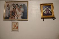 Bronx, NY Oct. 12, 2014 Family photos on the wall of the Harris residence. Photo by M.B. Elian