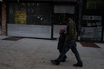 Bronx, NY Oct. 12, 2014 Every morning Travis walks his son 10 blocks to his school. On the way they practice Spanish and review homework. Photo by M.B. Elian