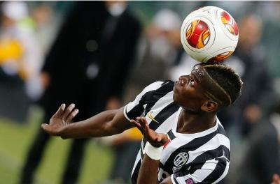 Juventus' Pogba controls the ball during the Europa League soccer match against Benfica at the Juventus stadium in Turin