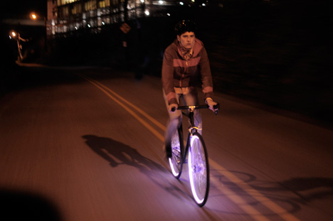 Person riding bike demonstrating Project Aura Bicycle Lighting System, via Core77
