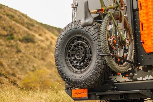 van compass tire carrier