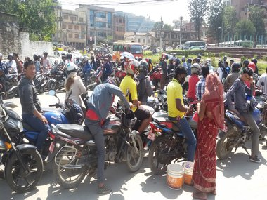 Long lines as Kathmandu waits to refuel. Pictures by Jessica Tradati