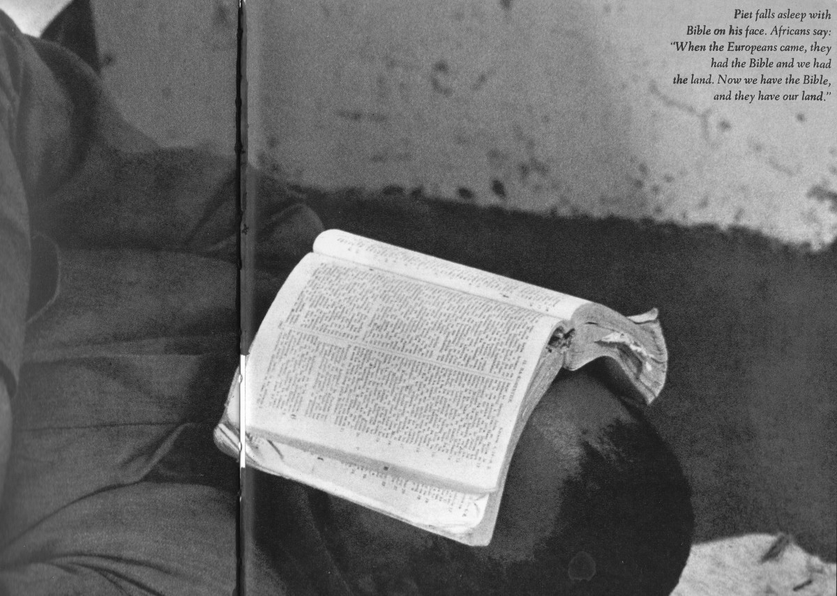 The caption reads: Piet falls asleep with Bible on his face, Africans say: When the Europeans came, they had the Bible a. Now we have the Bible, and they have our land.""