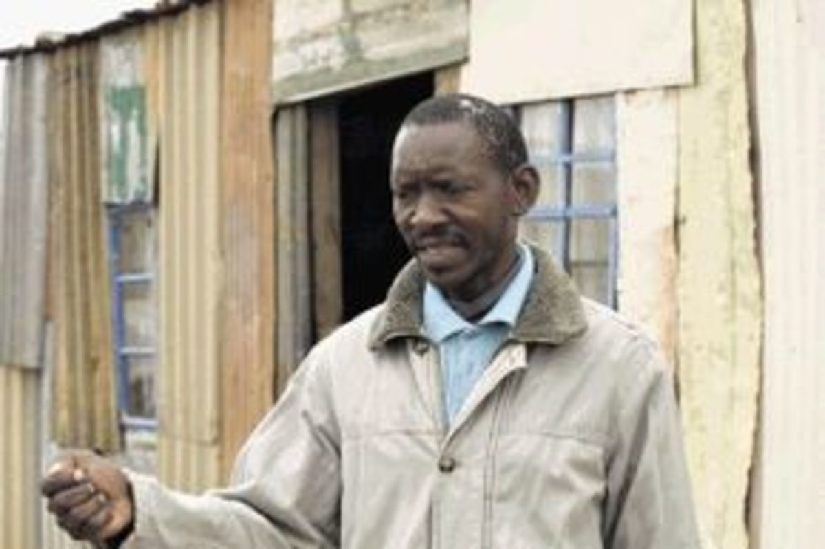 Mr. Ntlantla Vilakazi who has is being forded off his land for a fee of R20,000 AND AN RDP HOUSE