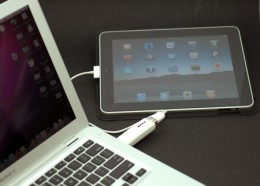 iPad being charged via USB cable