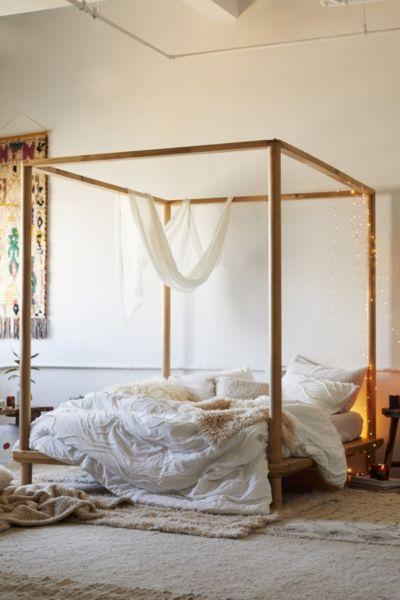 eva wooden canopy bed