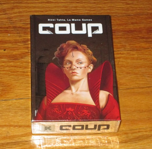 The box cover for the second edition of Coup