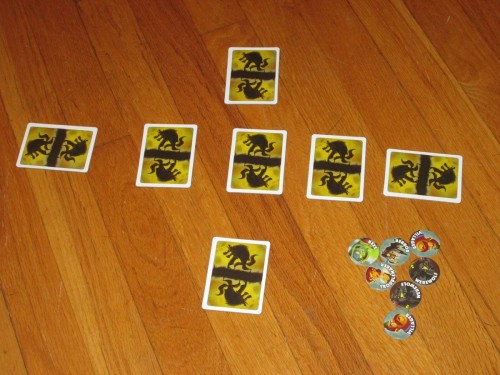 The game set up for four players. The tokens mark which roles are present in the game.