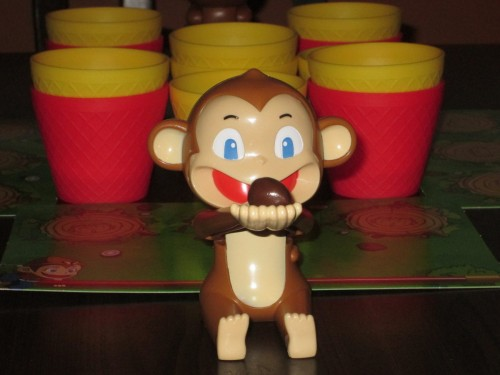 This monkey is ready to hurl his coconut into the nearest cup.