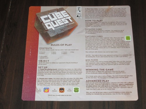 The rules for the game. One sheet. The back of the rules has a cube glossary, but most of that information is also included on the player aid.