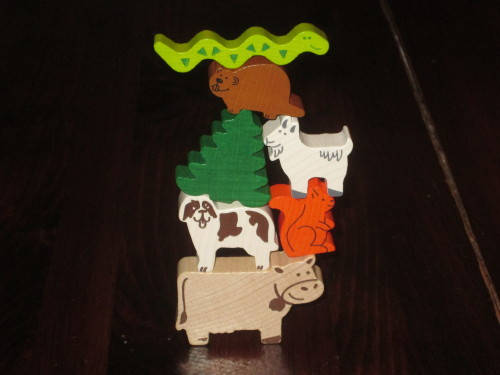 The seven animals in Crest Climbers. (I still call the pine tree an animal because it's easier.) The only duplicate is the snake. These...are challenging to stack, which is the point.