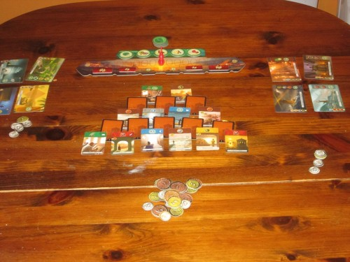 The game set up. Small cards keep the table space manageable.