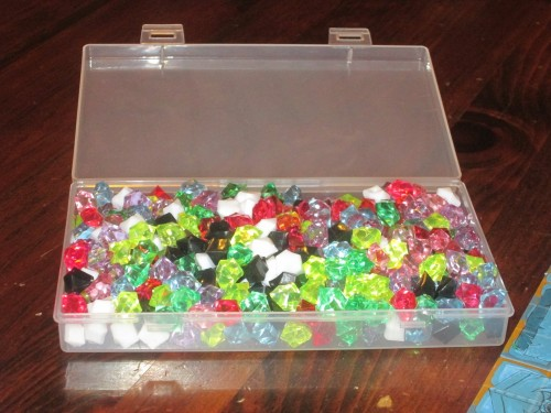 The game comes with a plastic storage chest for the gems. This is a great way to keep the gems contained.