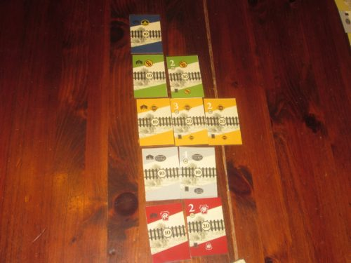 Each company has its own start card and rail line, which is expanded throughout the game on city and locomotive tricks.