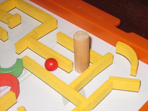A wooden spacer is included for each player to ensure that corridors are wide enough for the ball to pass.
