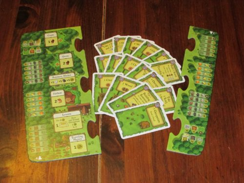 The old edition had you sort and place cards to scale the game for more players. The new version uses puzzle pieces.