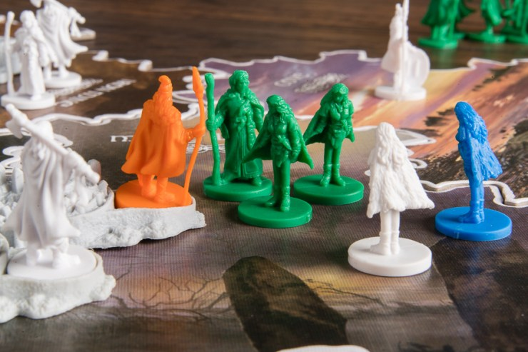 Multiple players can be involved in a clash. The orange player has found safety behind the walls of a citadel.