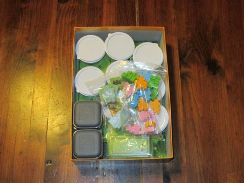 Agricola: Family Edition, like its ancestor, includes lots of plastic bags. to store the pieces. And like its ancestor, I've sprung for my own solution (in this case, baby food containers from the dollar store).