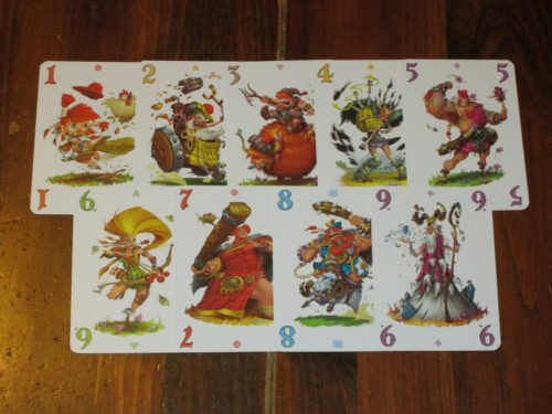 The number cards in Schotten-Totten. Each number card of the same rank has the same artwork, but the artwork differs from rank to rank. It's lighthearted, colorful, and fun.