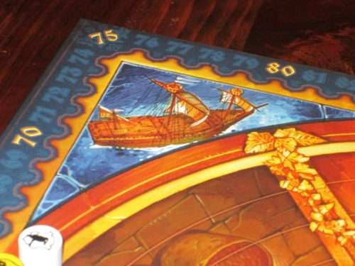The board is lavishly illustrated, even the little details, like these ships in the four corners of the board.
