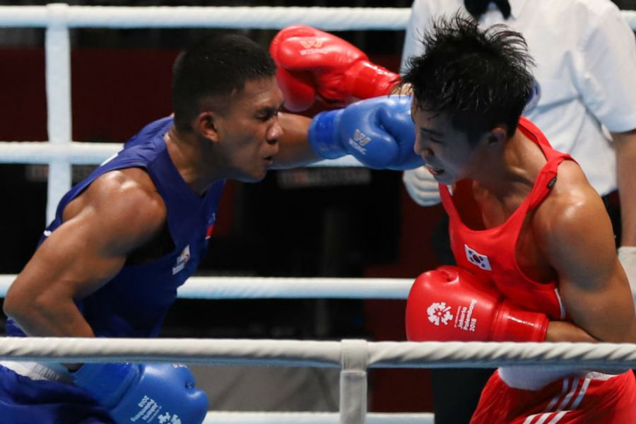 Asian Games  Why Eumir Marcial has best chance to win boxing gold     Eumir Marcial  left  takes the fight to South Korea s Kim Jinjea in their  middleweight quarterfinal bout in the 2018 Asian Games in Jakarta on  Wednesday