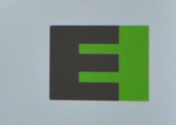 Schwarzes E mit gruenem Hintergrund. Zukuenftig das Symbol fuer SAAB Elektromobilitaet