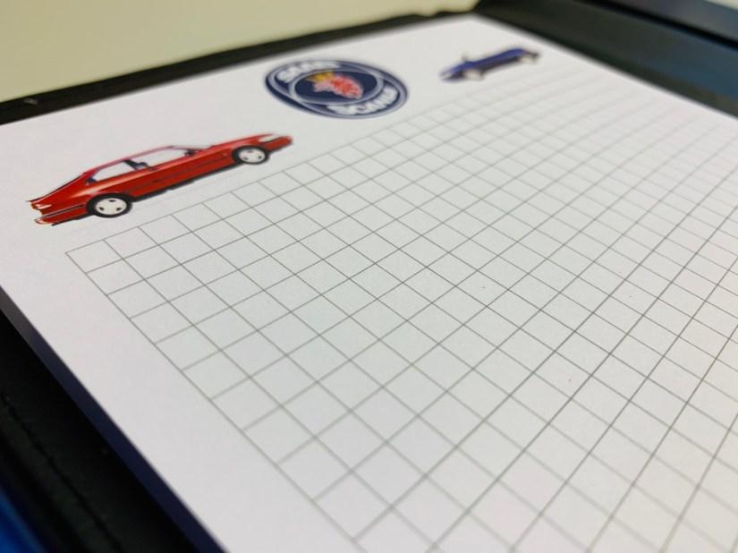 Carpeta de Saab y blog con el logo de Saab-Scania.