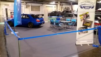 Subaru Impreza Sti Spec-C in background