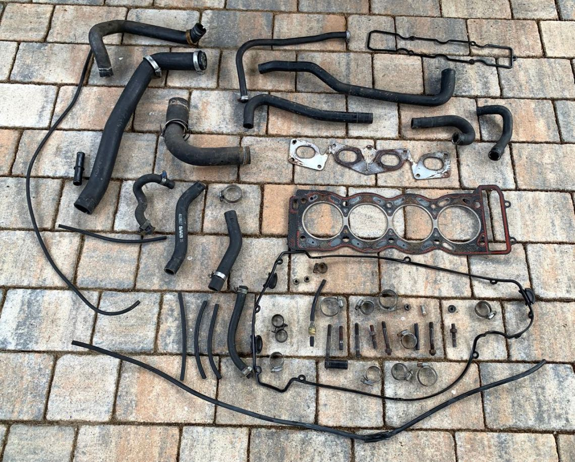 A new cylinder head gasket and new hoses for the Anna project